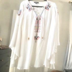 Adorable white bell-sleeved dress